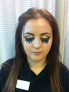 Creative eyeliner look with black and iced gold, then tear drops from multi pink glitter
