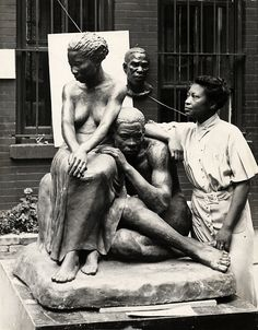Augusta Savage with one of her sculptures, ca. 1938. From the collection of the Archives of American Art