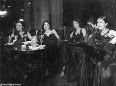 "Five ""Taxi Girls"" wait for customers at a Parisian nightclub, One of the women hides her face with her hands. They were called Taxi Girls because they offered dances with clients for a fee. Professor, Nation State, This Girl Can, Second Empire, World War One, Dance Hall, Early Childhood Education, Historical Photos, Black Satin"