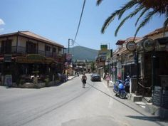 The main street in Alykes, Zakynthos, with it's restaurants, bars and souvenir shops.