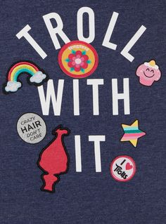 Keep her in tune with her favourite animation with this Trolls tee, featuring charming badge appliqués and a cool centre print: 'Troll With It'.  Navy Trolls badge top Short sleeves Crew neck Print design Appliqué detail Dropped hem Keep away from fire