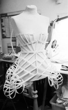 Pinned to costumes - looks: Cage Dress with scaffolding-like 3D...