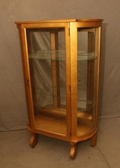 """Single door curio cabinet having mirrored back and two removable glass shelves on casters, 35""""x14""""x61""""T"""