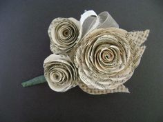 vintage book page spiral rose wedding corsage or boutonniere with burlap leaves for lapel or wrist. $15.00, via Etsy.