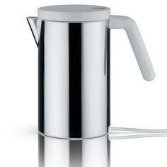 This Alessi Short Hot It electric kettle has a modern and stylish design with a white handle and lid. It is made from 18/10 stainless steel with the base and handle made from thermoplastic resin.�
