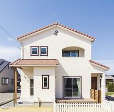 自然素材に囲まれたナチュラルな雰囲気のかわいい家