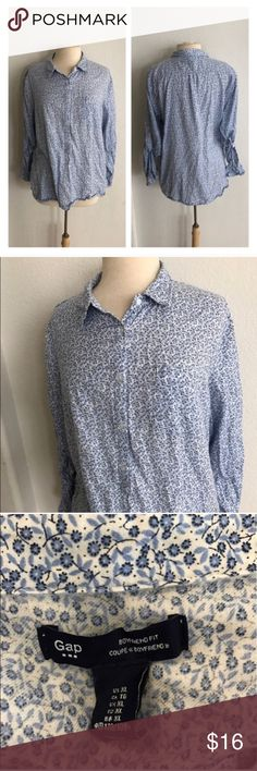 "GAP floral button down GAP blue floral button down. Size XL. Measures 27"" long with a 44"" bust. Buttons halfway down. This has no stretch. Very good used condition!  🚫NO TRADES 💲Reasonable offers accepted 💰Ask about bundle discounts GAP Tops Button Down Shirts"