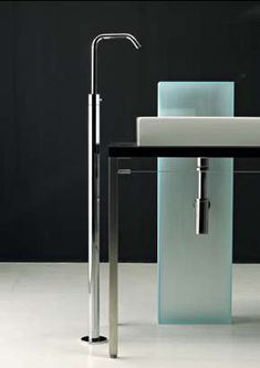 A faucet that reaches new heights, the Titanium Standing Lavatory Mixer dramatically drops water into the free-standing designer basin of your choice. A simple linear design, the Titanium floor-mounted...