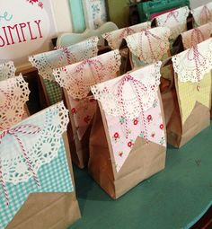 Darling Treat bags.  Doily tops and a great way to use up your piles of scrapbook paper or fabric scraps.