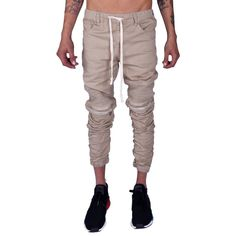 Slim Tapered Fit True to size waist Elastic waist with drawcord Elastic ankle cuffs Elastic calf seams for a natural stacked look 2 front slant pockets 2 rear patch pockets Pin-tucked Moto Paneling above the knee Dual zipper knee embellishments Cotton Khaki Joggers, Khaki Pants, Pin Tucks, Parachute Pants, Elastic Waist, Calves, Slim, Zipper, Legs