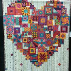 Heart quilt....This appears to be a variation on Gypsy Wife design, with all the blocks forming the heart, rather than being scattered about the surface. Clever idea!