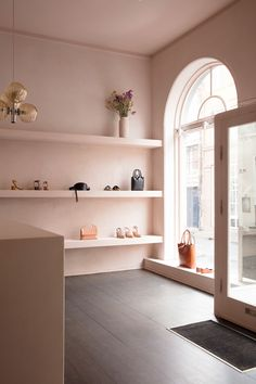 """Tuscany's """"sun-faded"""" buildings informed the interior of this pared-back accessories boutique in Copenhagen, which Danish brand St Leo has washed with soft-pink plaster. Small Apartment Interior, 1st Apartment, Studio Apartment Decorating, Retail Interior, Apartment Design, European Apartment, Decorating Kitchen, Kitchen Decor, Decorating Ideas"""