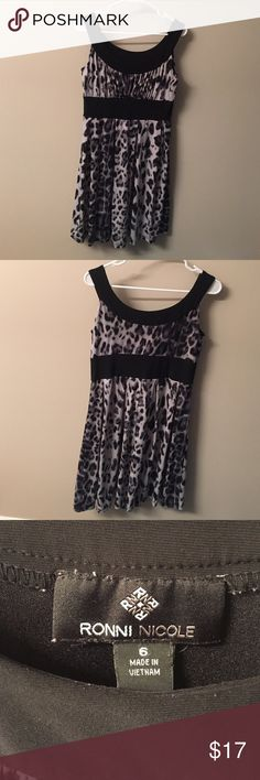 Ronni Nicole size 6 dress Very cute Ronni Nicole dress! Flirty and fun scoop neck cheetah dress. Only worn once. Can be dressed up or down for a more date night look. Very comfortable and easy to clean material. Excellent condition. Make an offer! :) Ronni Nicole Dresses