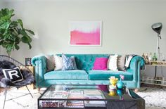 Grey Accent Wall And Accessories With Turquoise Couch