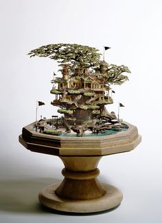 Takanori Aiba - sculpture.  Notice that this very tiny project is wrapped around a bonsai tree.