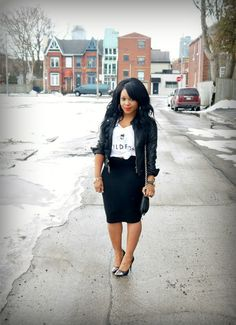 Pencil skirt, leather jacket, tied up tee and bold lips.