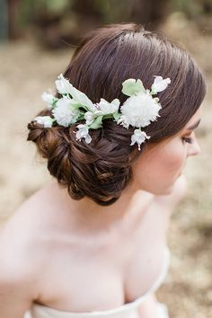 low updo wedding hairstyle with white elodie flower comb