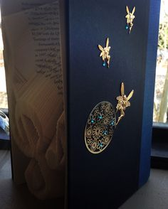 Gold angels for book cover design and handmade folded music note artwork design.