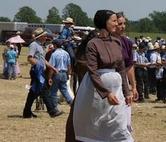 """2 Amish ladies, both unmarried, and look like sisters. The black prayer caps say """"not married"""". These ladies are from the Milverton, Ontario Amish community, where """"capes"""" are not a part of a woman's costume."""