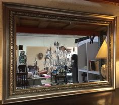 44X31 INCH ENTRYWAY OR HALL MIRROR. THIS BEVELED MIRROR IS SET IN A PEWTER COLORED FRAME WITH RAISED BORDERING AND IS IN GOOD CONDITION, READY FOR HANGING.
