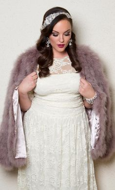 For a winter wedding, try our plus size Illusion Lace Wedding Gown with a gorgeous faux fur.  Browse our entire made in the USA collection and see more style inspiration online at www.kiyonna.com.  #KiyonnaPlusYou