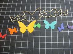 MB Blissful butterflies cut out of a rainbow of glitter papers