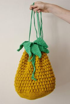 This cute, fun pineapple bag features puff stitch to achieve a life-like pineapple texture! Worked in the round from a flat base, this drawstring bag will be the talk of the summer.