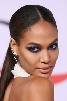 This smoldering, blue eye makeup look from Joan Smalls is worth copying.