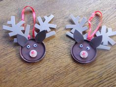 Paint a juice can lid brown. Paint a small wood circle tan. Cut ears and antlers from foam and glue to lid. Add googly eyes, the wood circle with a red bead for the nose and a ribbon hanger.