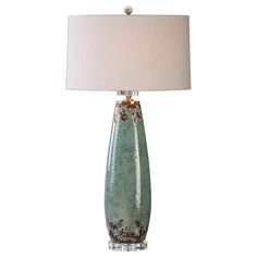 Crackled, Pale Mint Green Ceramic With Gray Distressing And Rust Undertones Accented With Brushed Nickel Details And A Crystal Foot. The Slightly Tapered Oval Hardback Shade Is A Light Beige Linen Fabric. Due To The Nature Of Fired Glazes On Ceramic Lamps, Finishes Will Vary Slightly. Crackled, Pale Mint Green Ceramic With Gray Distressing And Rust Undertones Accented With Brushed Nickel Details And A Crystal Foot.