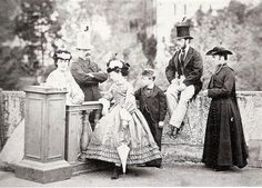 Princess Margherita (later Queen of Italy) and Prince Thomas of Savoy (later 2nd Duke of Genoa) with their tutors.