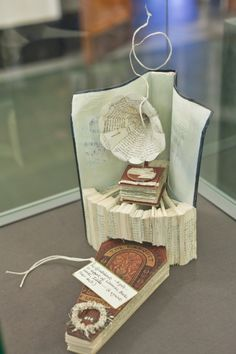 A coffin, topped by a large gramophone showed up suddenly at The National Library of Scotland. It was left by by an anonymous artist with the twitter name @ByLeavesWeLive.  The scene was carved from a mystery novel by Ian Rankin called 'Exit Music'.