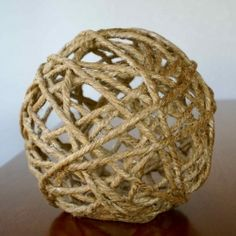 Make your own twine ball tree topper following this easy tutorial via The Thinking Closet.