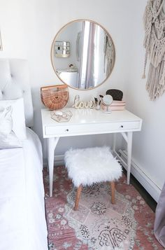 A round wall mirror that doubles as an accent decor piece