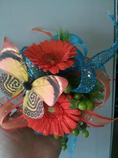 Wrist corsage with butterfly accent.