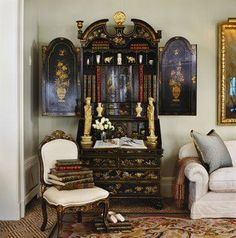 Beautiful antique secretary desk and Asian statues tucked in a corner.