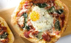 Bacon, egg and spinach breakfast pizza~cook it longer than it says BEFORE you put the eggs on, then drizzle w/ truffle oil just before you eat it <3