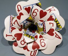 Tutorial for making a playing card flower hair clip.