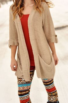 Beige oversized cardigan, orange layering cami, printed fleece leggings. Super cute outfit!