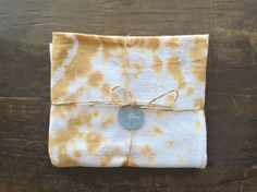 Hand dyed shibori style flour sack towels tye dyed in a butterscotch yellow and white. These lovely little kitchen towels are a labor of love