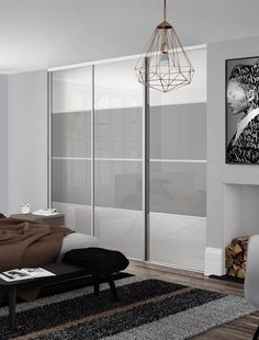 Classic 4 panel sliding wardrobe doors in Pure White and Light Grey glass with Silver frame.
