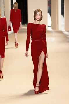 Ellie Saab. Love this red dress! I have broad shoulders so, not sure that I could pull that off but still...