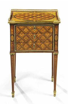 A LOUIS XVI ORMOLU-MOUNTED TULIPWOOD, AMARANTH, SYCAMORE AND FRUITWOOD MARQUETRY TABLE-EN-CHIFFONIERE  ATTRIBUTED TO GUILLAUME KEMP, CIRCA 1775
