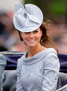 June 16, 2012: Kate joined Prince Harry and Camilla for a carriage ride during Trooping the Colour, the Queen's official birthday celebration. Kate opted for a Canadian designer for the parade, wearing an embroidered pearl-grey sheath by Erdem, a suede Alexander McQueen clutch, a matching hat by Jane Corbett and recycled (of course) silver earrings by Links of London.
