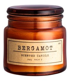 Dark orange/bergamot. Small, scented wax and paraffin candle in a glass holder with a label. Burn time approx. 15 hours. Diameter at top 1 3/4 in., height 2