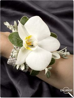 single orchid wrist.. FOR THE MOTHER OF BRIDE AND GROOM AND GRANDPARENTS ..