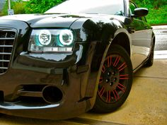 chrysler 300c 2.7L 2007 black red rims wheels grill bumper body kit lights ground fx interior halos custom interior exterior clean rear front side skirts carbon fiber pillars vents mesh tricked out blacked out w red accents