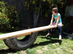 You can build this backyard tire see saw. Scroll down to link for treehouse and playhouse designs
