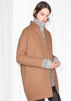 Crafted from a warm wool-blend, this cold-weather coat has a round, voluminous silhouette and features fine cutting and stitching details.
