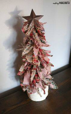 Learn how to make these primitive mini Christmas trees with homespun fabric, wooden dowel, metal star and birch wood pillar stand. Fits right in with rustic country Xmas decorations. Holiday craft ideas that kids can make. Easy crafts for the holidays. Tree Crafts, Christmas Projects, Holiday Crafts, Christmas Diy, Country Christmas Crafts, Primitive Christmas Tree, Primitive Christmas Decorating, Rustic Christmas Ornaments, Primitive Snowmen